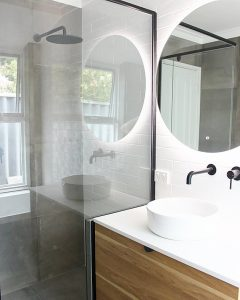 round mirror bathroom sink and shower