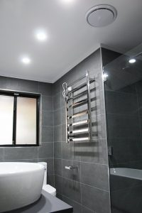 heated towel rack in bathroom